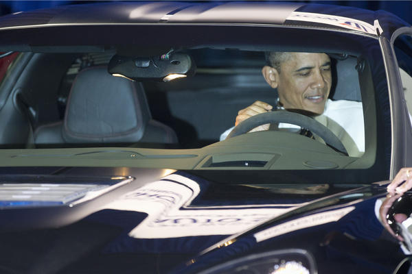 President Obama sits inside a Chevrolet Corvette ZR1 during his visit to the Washington Auto Show at the Washington Convention Center on Jan. 31, 2012.