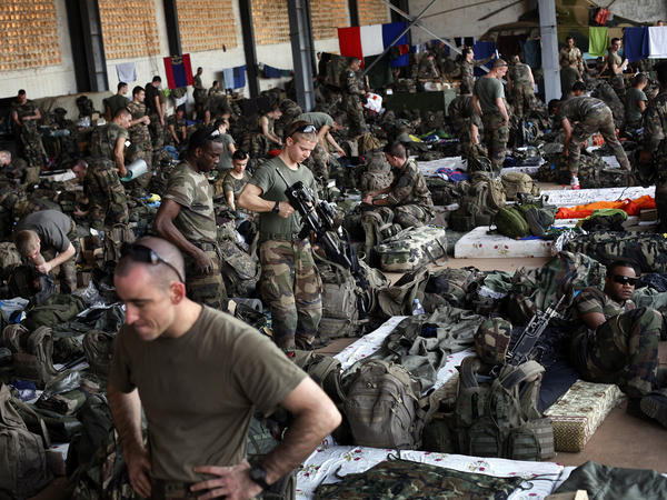 French troops gather in a hangar at Mali's Bamako airport. French forces led an all-night aerial bombing campaign against armed Islamist extremists Tuesday.