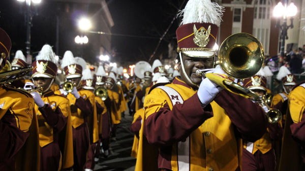 The McDonogh 35 High School band marches in a parade to usher in the Carnival Season.