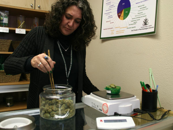 Erica Freeman of Choice Organics weighs medical marijuana for a customer.