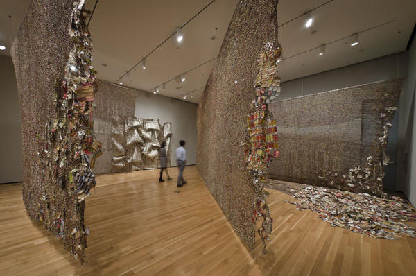 "Anatsui's <em>Gli</em> (2010) was inspired by the artist's visit to three cities – Berlin, Jerusalem and Notse, Togo — whose histories have been shaped by walls. In the Ewe language, which is spoken in Togo, ""gli"" can mean ""wall,"" ""disrupt"" or ""story."""
