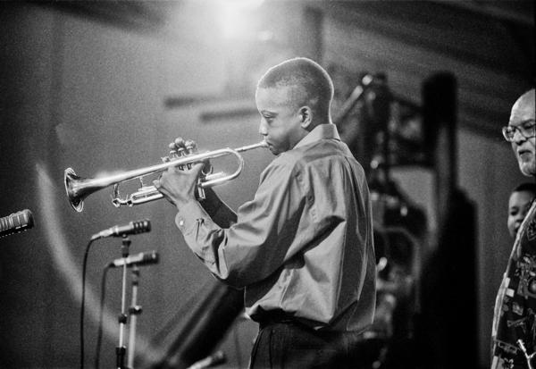 "Bolen shot one of Troy ""Trombone Shorty"" Andrews' earliest public performances at the 2001 Jazz Fest. Andrews' teacher Clyde Kerr can be seen at the far right."