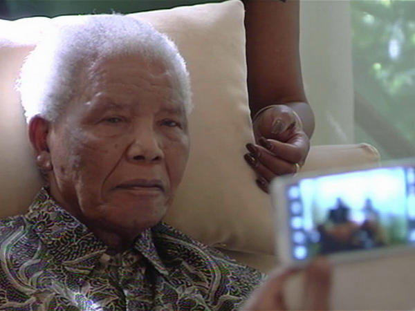 The poor health of the anti-apartheid icon (shown here in this image taken from video April 29) has attracted a swarm of foreign journalists to South Africa.