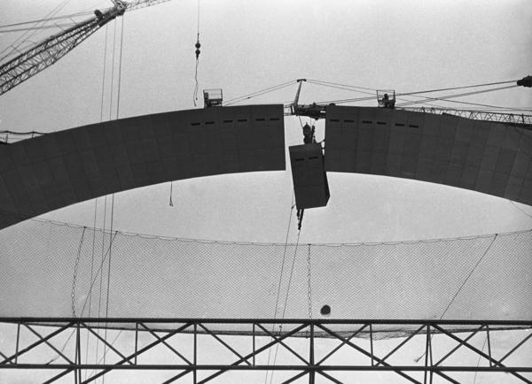 The next-to-last 8-foot stainless steel section is fitted into the top of the Arch on Oct. 19, 1965.