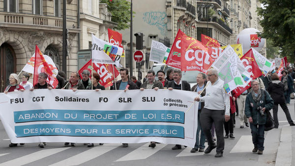 Demonstrators in Paris protest Thursday against a measure to teach more university courses in English.