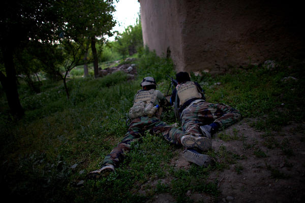 ANASF soldiers hold down a position as other members of their team patrol nearby. Taliban forces have traditionally used the area as an infiltration route and staging area because of its proximity to Kabul, which is about an hour away.