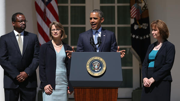 President Obama announces  in the White House Rose Garden on Tuesday his nominations of (from left) Robert Wilkins, Cornelia Pillard and Patricia Millett to fill vacancies on the U.S. Court of Appeals for the District of Columbia.