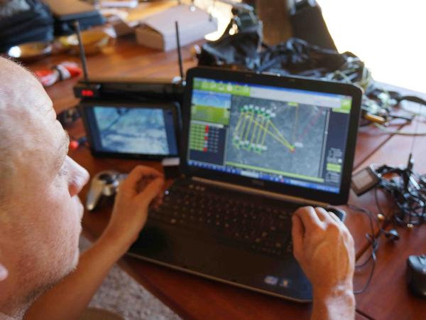 Chris Miser, owner of Falcon UAV, uses a laptop to control and monitor an unmanned aerial vehicle in test flights in May at Olifant West, a private game preserve in South Africa.