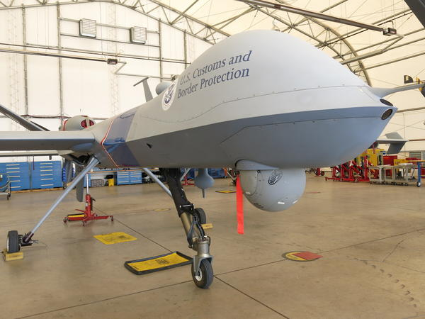 The equipment hanging from the Customs and Border Protection drone's underbelly includes a night camera, a day camera, a low-light camera and laser target illumination.