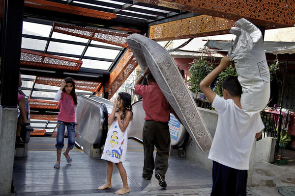 Electric escalators have been installed in Comuna 13 to ease the commute for people who live high in its upper reaches.