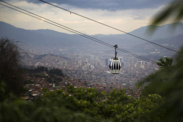 The cable-car system moves tens of thousands of people each day, connecting them to a modern metro.