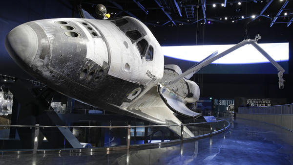 The space shuttle Atlantis, with its cargo arm extended, goes on display today the Kennedy Space Center Visitor Complex in Cape Canaveral, Fla.