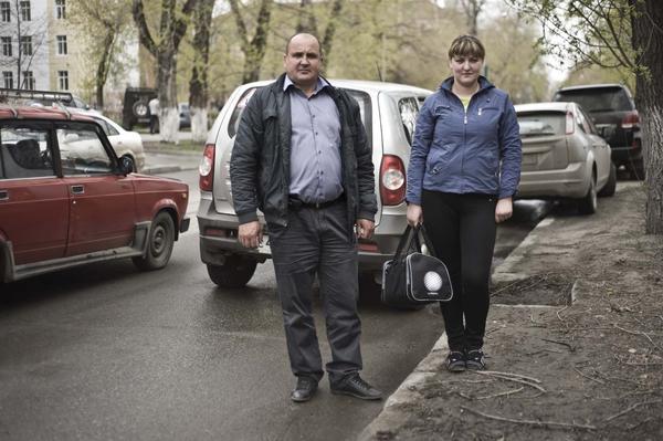 Driver Sergei Goryunov and nurse Yulia Safronova travel around Tomsk, Russia, treating the homeless and alcoholics for tuberculosis.