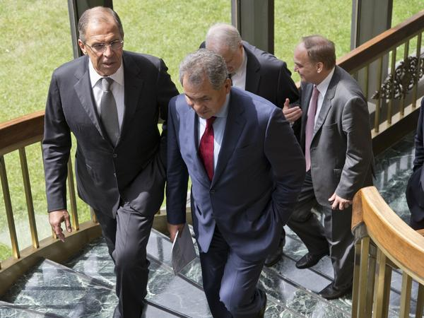 Russian Foreign Minister Sergei Lavrov, left, and Defense Minister Sergei Shoigu, right, walk to their news conference at the Russian Embassy in Washington on Friday.