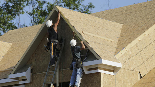 Carpenters work on a housing site in Brandywine, Md., on May 31. Pent-up demand for homes could create jobs and help the struggling U.S. economy.