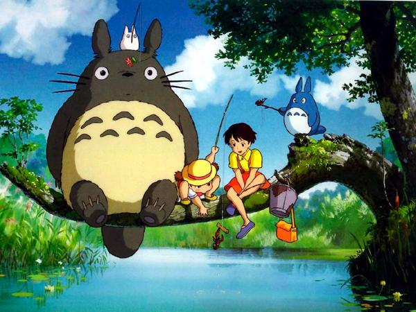 Hayao Miyazaki's film <em>My Neighbor Totoro </em>features the young sisters Mei and Satsuki, seen here sitting next to the whimsical and outsized Totoro.