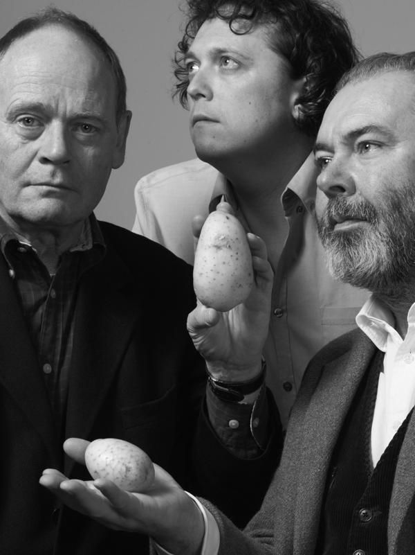 From left: John Lloyd, James Harkin and John Mitchinson dig up interesting information for the BBC quiz show <em>QI.</em>