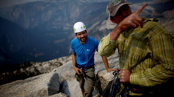 Nate Watson, whose left arm is partially paralyzed from a gunshot wound in Afghanistan, arrives at Half Dome's summit with guide Pat Warren.