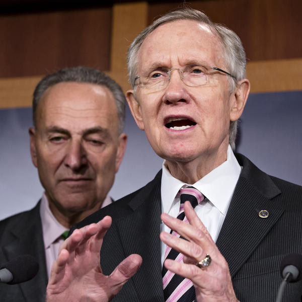 "Senate Majority Leader Harry Reid, accompanied by Sen. Charles Schumer, D-N.Y., tells reporters that Republicans need to ""get a life and talk about something"" other than Obamacare."