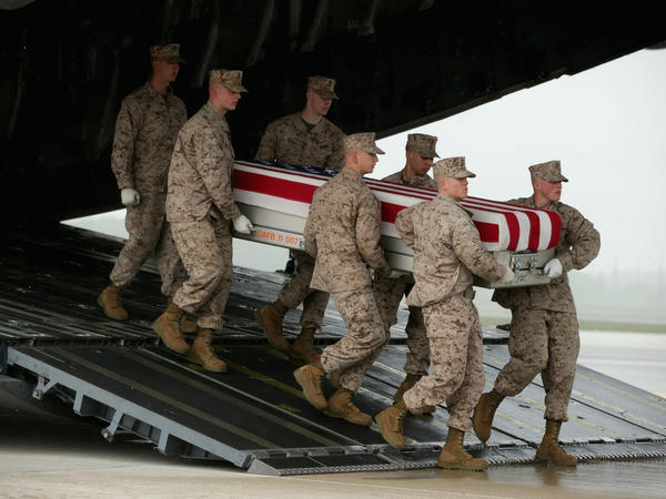 The remains of a U.S. soldier killed in Afghanistan in May arrive at Dover Air Force Base in Delaware. In <em>Breach of Trust,</em> writer and veteran Andrew Bacevich asks whether we the people are sufficiently connected to those who fight our wars — and die in them.