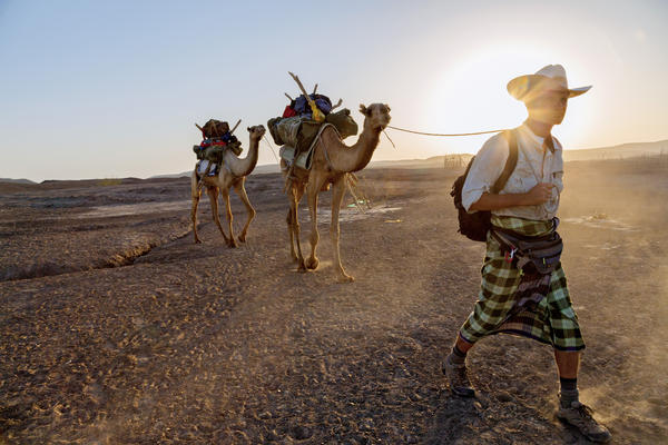 """Paul Salopek and his guide walk into the desert, on day 19 of the """"Out of Eden walk"""" in the Afar region of Northeast Ethiopia. The walk with take about 7 years total."""