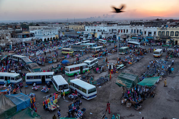 Along the route is Central Market in Djibouti City, Djibouti. An urban oasis, the central market pulses with traffic. Buses bring migrants who, Salopek says, have changed in a generation from premodern pastoralists to hustling wage-earners in this city of 500,000.