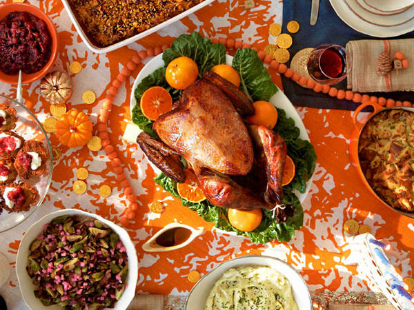Manischewitz-brined turkey centers the Thanksgivukkah feast, surrounded by challah-apple stuffing, sweet potato bourbon noodle kugel, horseradish-spiked mashed potatoes, brussels sprouts with pastrami and pickled onions, and latkes with cranberry applesauce.