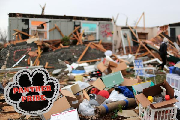 A Panther Pride sign cheers  Washington High School's undefeated football team amid debris from last week's tornado.
