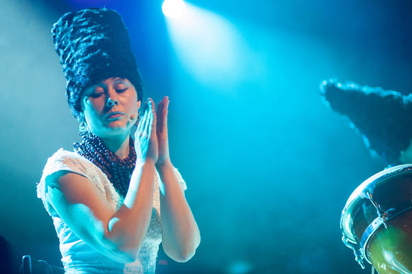 """Devo meets Davy Crockett: a member of the furry-hatted Ukrainian """"folk-punk"""" band DakhaBrakha onstage Sunday during globalFEST at New York's Webster Hall."""