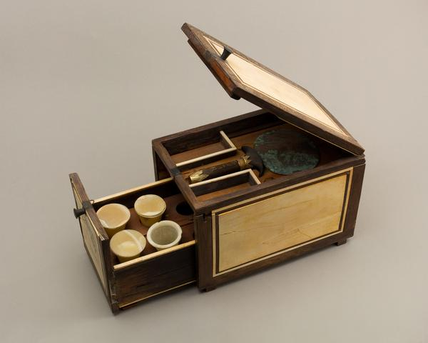 This Egyptian cosmetic box of the cupbearer Kemeni, circa 1814-1805 B.C., is made of cedar, ebony, ivory and silver.