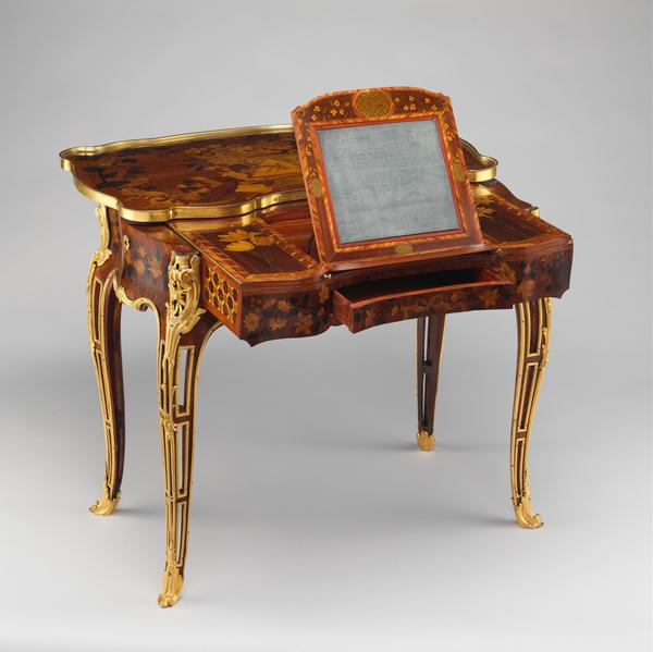 This French mechanical table was intended for Madame de Pompadour. The designs depict her many interests, including gardening, painting, music and architecture.