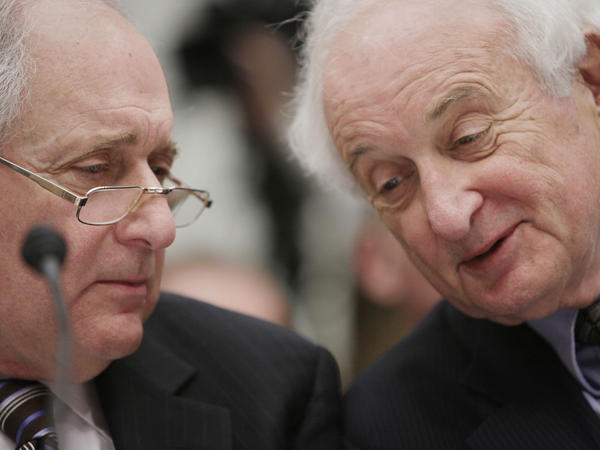 Carl Levin (left) huddles with his brother Sandy.