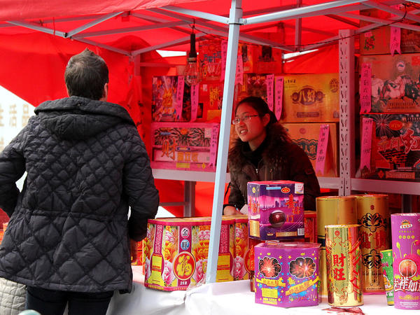Vendors sold everything from Roman candles to long strings of firecrackers from street corners — though some reported sluggish sales.