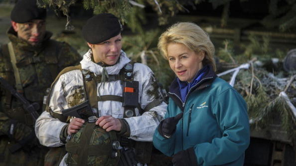 Germany's new defense minister, Ursula von der Leyen, right, chats with German soldiers who have served in Afghanistan, at a training center in Letzlingen on Jan. 28. Von der Leyen has said she would like to see German forces participate more with other European troops in foreign peacekeeping missions.