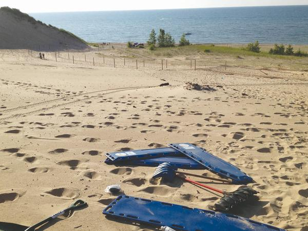 Rescue gear sits on the sand on Mount Baldy in the Indiana Dunes in July 2013 after a 6-year-old boy was rescued from a mysterious hole that buried him for three hours. Lake Michigan is in the background.