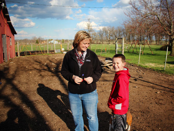 After a day at the office, Devin Fisher and her son Gunnar check on their cattle.