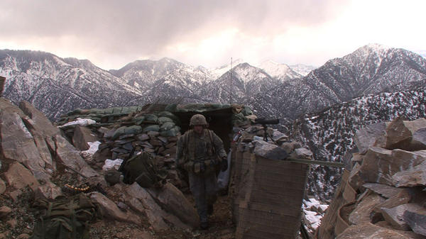 Sgt. 1st Class Mark Patterson checks his men at Outpost Restrepo in Afghanistan, as documented in the new film <em>Korengal</em>.
