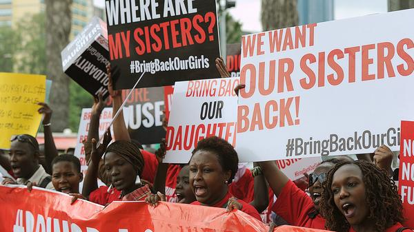 Activists from a coalition of more than 40 African women's organizations march May 15 in Kenya's capital Nairobi, demanding the release of more than 200 girls abducted from schools in northern Nigeria by Muslim extremist group Boko Haram.