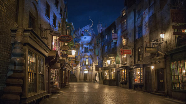 The fire-breathing dragon that helped Harry and his friends escape from the banker goblins sits on top of Gringotts Wizarding Bank in Diagon Alley, Universal Orlando's newest attraction.