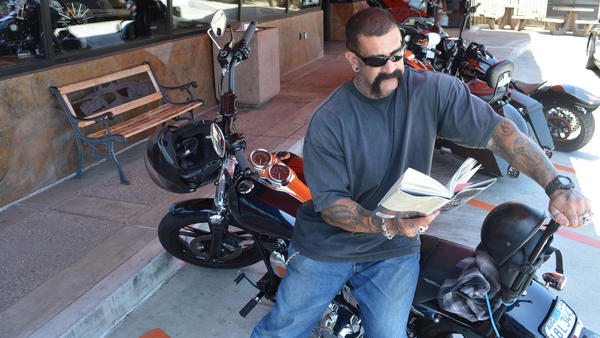 "Biker Ron Hamberg says he's read Dickens, Twain and Gandhi's autobiography, but as for books about motorcycles, ""I just ride 'em, I don't read about 'em."""
