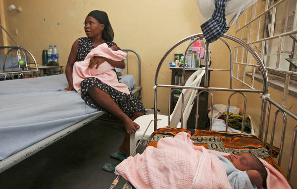 Seun Dupe sits with her newborn twins in a maternity hospital in Lagos, Nigeria. Nigeria is Africa's most populous country with more than 160 million people. UNICEF estimates that number will swell to nearly 1 billion by 2100.
