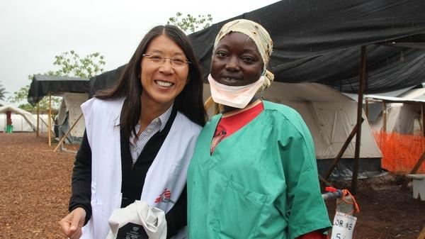 Dr. Joanne Liu (left), international president of Doctors Without Borders poses with a member of the MSF medical team at the organization's Ebola treatment center in Kailahun, Sierra Leone.