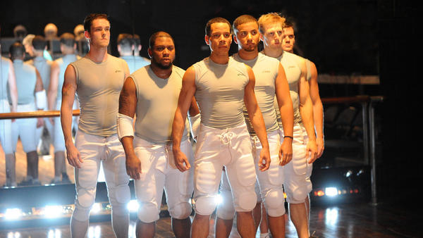 Marcus (Jon Hudson Odom) and his teammates in the Olney Theatre Center's production of <em>Colossal.</em>