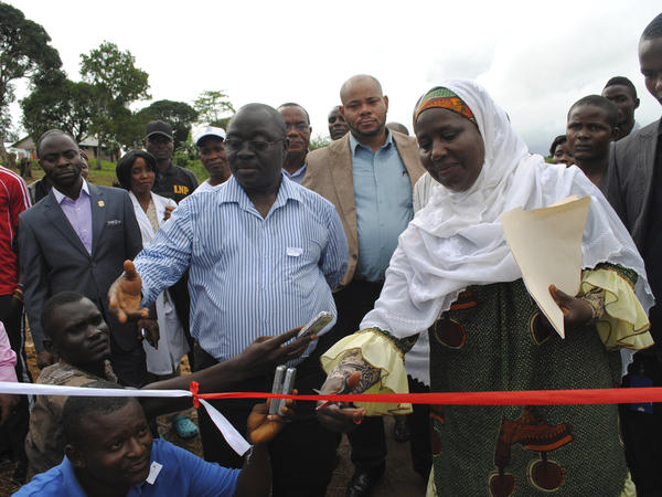 A positive sign: Liberian officials inaugurate the opening of a new Ebola treatment center outside Monrovia on Oct. 3. In the past few weeks, hundreds of beds have become available for Ebola patients around Monrovia.