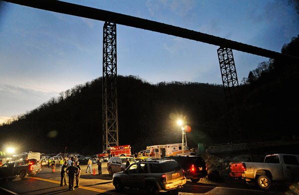 Police direct traffic at Massey Energy's Upper Big Branch coal mine in Montcoal, W.Va., after an explosion there killed 29 men in April 2010. Upper Big Branch had delinquent mine safety penalties at the time of the explosion.