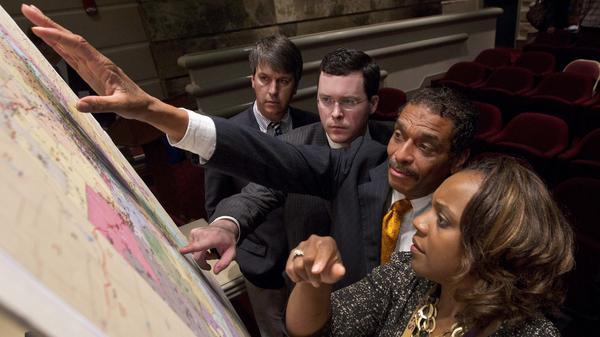 State Reps. Barry Moore, Joe Hubbard, Rod Scott and Merika Coleman study a map of the proposed redistricting plan in May 2012 following a meeting of the Legislative Committee on Reapportionment at the Alabama Statehouse in Montgomery, Ala.