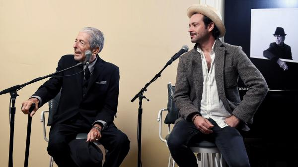 Leonard Cohen (left) and Adam Cohen speak at an event for the release of <em>You Want It Darker</em>.