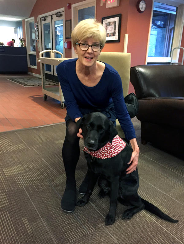 Karen Lorne, diagnosed with Lou Gehrig's disease in July, volunteers weekly with her certified therapy dog, Bailey, at the Ronald McDonald House in Chapel Hill, N.C.