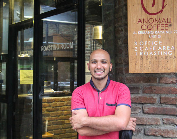 Irvan Helmi, founder of Anomali Coffee, stands outside his South Jakarta shop, which specializes in single-source coffees from around the Indonesian archipelago.