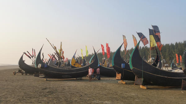 Fishing boats sit in the sunset on the beach in Teknaf in southern Bangladesh. Billed as the longest beach in the world, the Bangladeshi government has plans to turn the area into a tourist destination in hopes of bringing in badly needed jobs and investment.